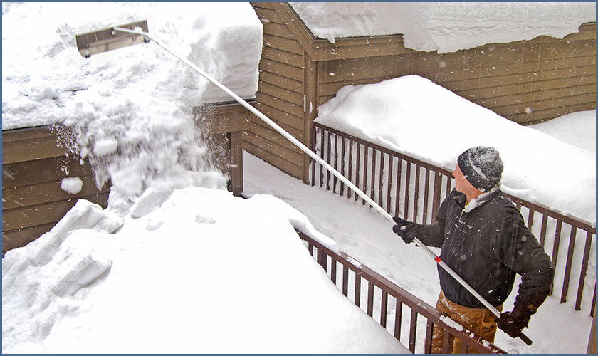 Fig. 2 - Example of a Roof Rake Being Used to Remove Snow Accumulation